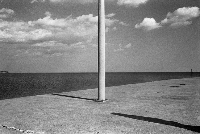 pole-with-shadow-at-lake.jpg